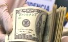 Traía Dólares Falsos en Maleta con Doble Fondo